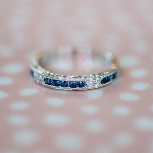 Incorporating a wedding band with blue sapphires adds a pophellip