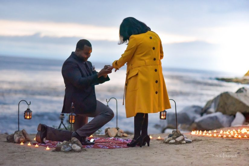 Couple getting engaged on the beach. Great proposal ideas