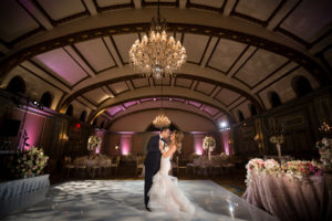 Bride & groom dancing at their reception with no one else in the room