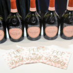 Popping the bubbly to celebrate Kirk Kara's tenth year win of the Jewelers Choice Award fro bridal