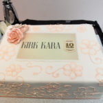 Wonderfully decorated cake celebrating Kirk Kara's tenth year win of the Jewelers Choice award fro bridal