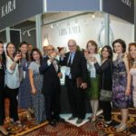 Group photo at the Kirk Kara booth at JCK celebration the Jewelers Choice tenth year win
