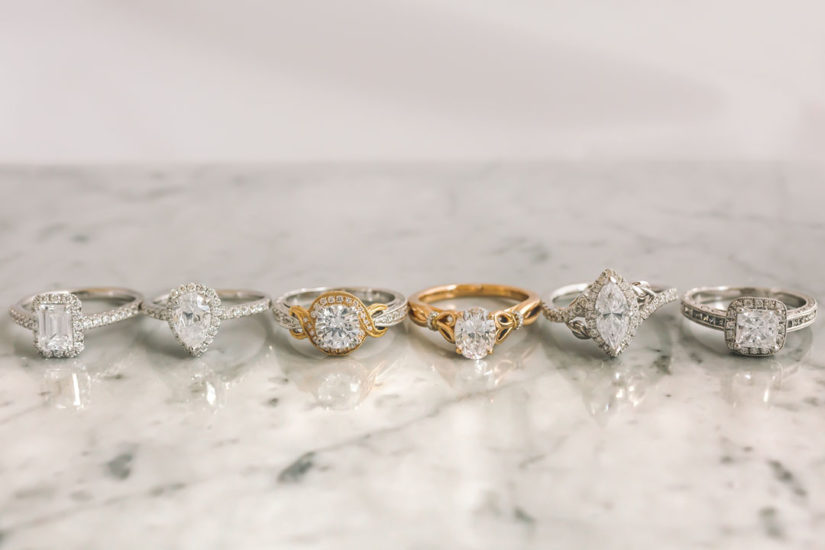 Kirk Kara wedding rings in white and yellow gold with diamonds